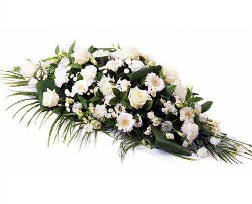 White-Casket-Spray Floral arrangements above and beyond funerals