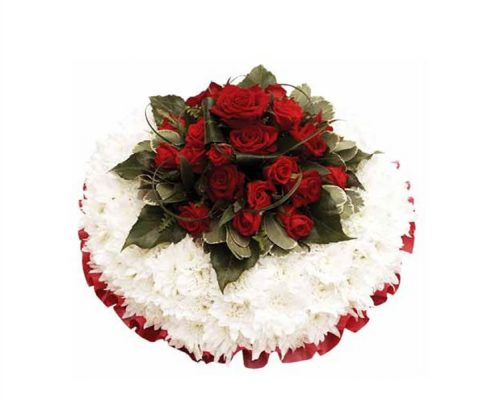 White-Wreath-with-Red Floral arrangements above and beyond funerals