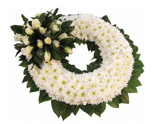 White-Wreath-with-Whit Floral arrangements above and beyond funerals