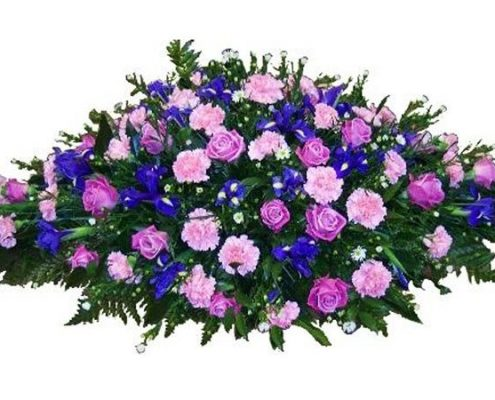 purple-and-pink-casket-sp Floral arrangements above and beyond funerals